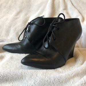 Clarks black leather wedge booties
